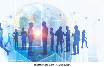 Silhouettes of business people over Earth hologram and immersive interface. Concept of international business. Toned image double exposure Elements of this image furnished by NASA