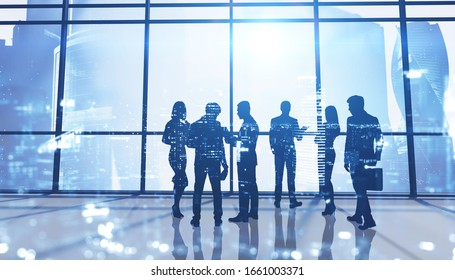 Silhouettes of business people in panoramic office with double exposure of blurry cityscape. Concept of business meeting and teamwork. Toned image