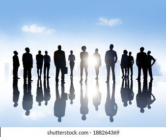 Silhouettes Of Business People Standing Outdoors In A Tranquil Urban Scene.