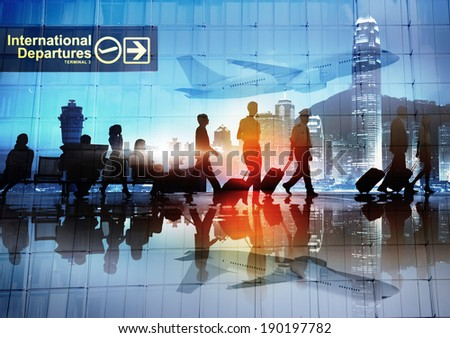 Silhouettes of Business People Walking in an Airport
