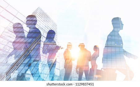 Silhouettes of business people walking and talking against a modern cityscape. Toned image double exposure mock up