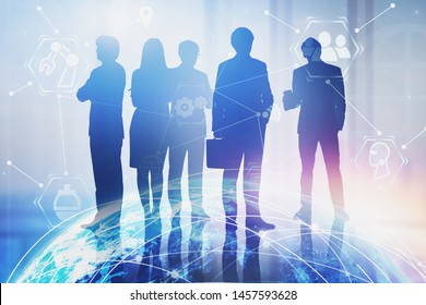 Silhouettes of business people working together in blurred office with double exposure of planet hologram and internet icons. Concept of hi tech. Toned image. Elements of this image furnished by NASA
