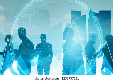 Silhouettes of business team members over cityscape background with graph and network hologram foreground. Planet hologram. Toned image double exposure