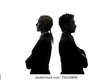 Silhouettes of caucasian businesswoman and asian businessman standing back to back.
