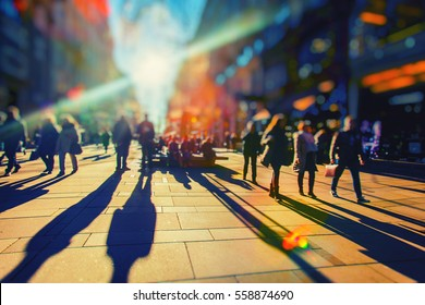 Silhouettes of colorful people walking down the street.