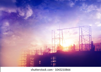 Silhouettes construction site at sunset sky. worke concept.