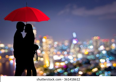 Silhouettes of couple against the blurred city, Romantic.