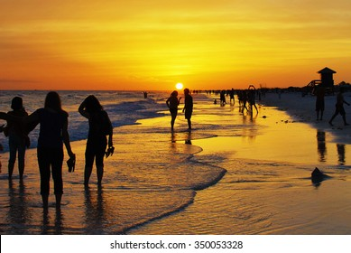Silhouettes of a couple during sunset at the Beach in Siesta Key beach Florida