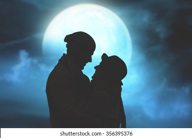 Silhouettes of a couple with starry and lunar background. Stars, Moon and silhouettes of people are my work. No elements of third party.