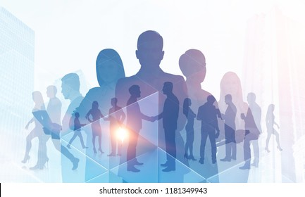Silhouettes of diverse business team members standing together and shaking hands. Cityscape, communication and teamwork concept. Triangle tiles foreground Toned image double exposure copy space