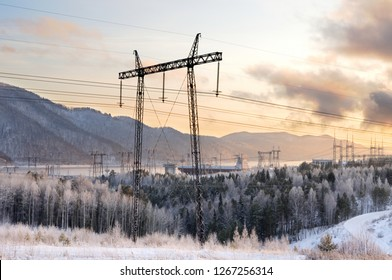 Silhouettes of electricity pylons during a winter sunset near the Krasnoyarsk Hydroelectric Power Station in Siberia, Russia