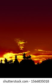 Silhouettes of the famous Bronze quadriga statue of goddess of Victory, Nike at the Austrian Parliament's roof during bloody sunset in Vienna