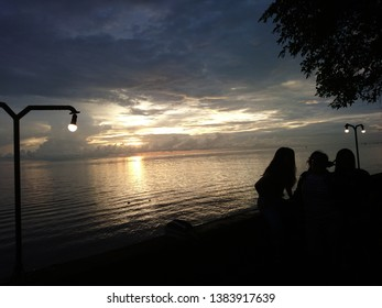 The silhouettes in a field sunset sky, light over the sea, Jan 18, 2019 Pontianak - Indonesia