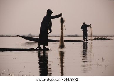 silhouettes of fishermen with sunrise at Inle lake, Myanmar, Burma, Asia