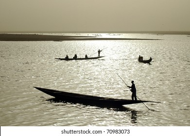 Silhouettes of fishermen in West Africa