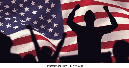 Silhouettes of football supporters against digitally generated united states national flag