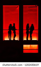 Silhouettes of girls in red light nightspot