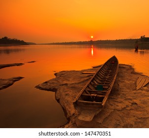 Silhouettes landscape view sunset and old wooden boats in mekong river ubon ratchathani province thailand