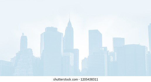 Silhouettes of the Manhattan skyline in New York City. Light blue image