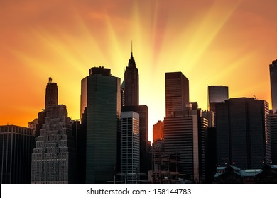 Silhouettes of Manhattan. Sunset in New York City.