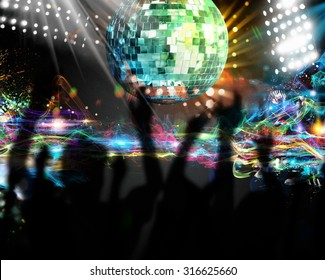 Silhouettes of many people dancing in nightclub