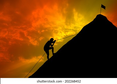 Silhouettes of men who try climbing.
