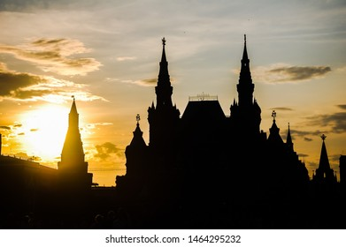 silhouettes of the Moscow Kremlin and the historical Museum against the Golden sky. The contrast against the light