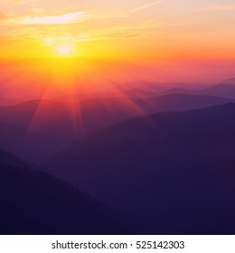 Silhouettes of the mountain hills at sunset. mountain cascade