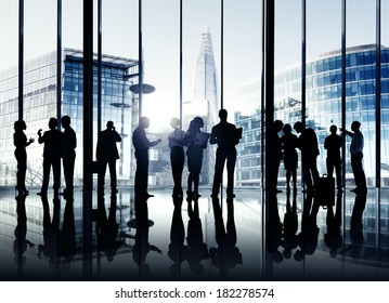 Silhouettes Of Multi-Ethnic Group Of Business People In Office