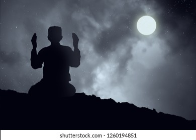 Silhouettes Muslim prayer,the light of faith, hope, faith, supplication,Concept of Islam is the religion, Young Muslim man praying mosque blurred background - Image