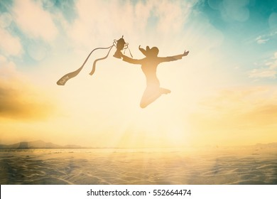 Silhouettes new victory champ woman hold trophy of ribbon jump on summer beach background concept for success student great future, good moment support, Autonomy freedom