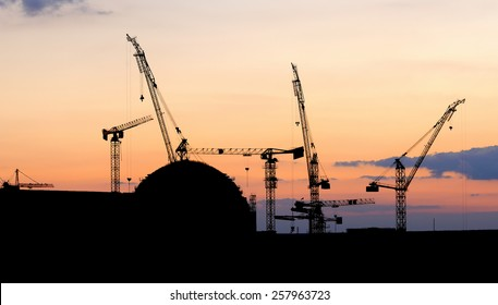 silhouettes of nuclear power plant under construction