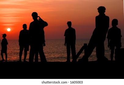 Silhouettes on the beach (Goa, India).