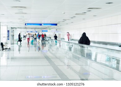 silhouettes of people at an airport arrival terminal