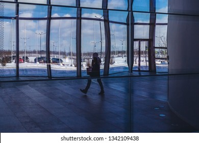 silhouettes of people in a business center
