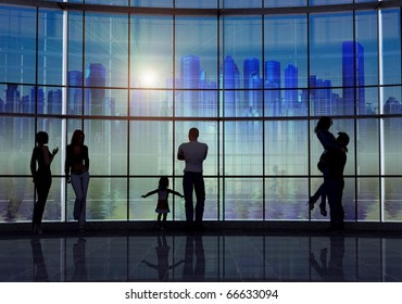 Silhouettes of the people in the city background.