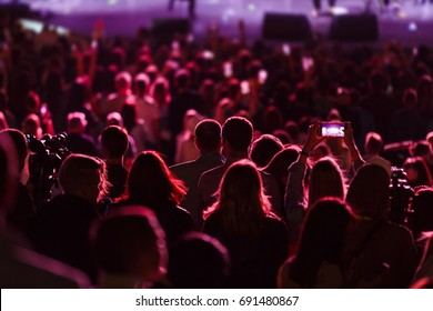 Silhouettes of people at the concert outdoors