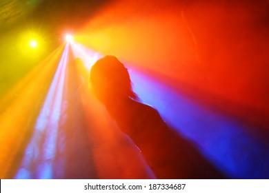 Silhouettes of a people dandin in a nightclub