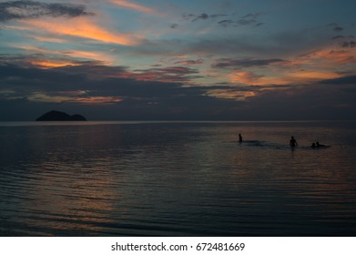 Silhouettes of People During a Sunset on Koh Pha Ngan, Thailand