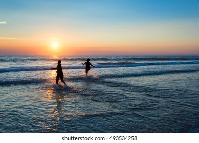 Silhouettes of people enjoying the sunset on the atlantic ocean, Lacanau France