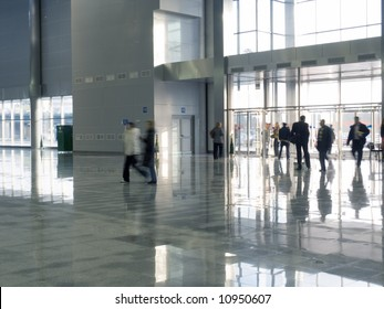 Silhouettes of people in a hall business of the centre
