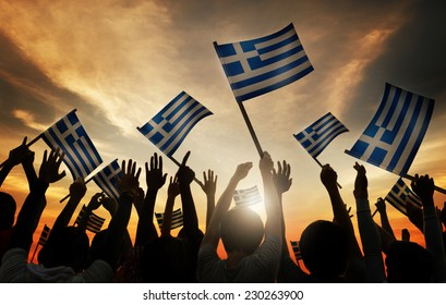 Silhouettes of People Holding Flag of Greece