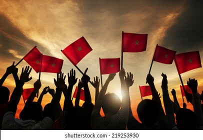 Silhouettes of People Holding Flag of Morocco