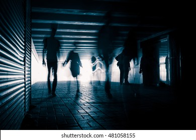 Silhouettes of people in the tunnel.