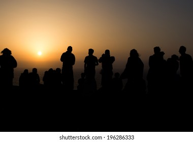 Silhouettes of people watching the sunset at Cape San-Vincente in Portugal
