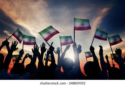 Silhouettes of People Waving the Flag of Iran
