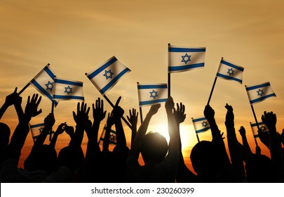Silhouettes of People Waving the Flag of Israel