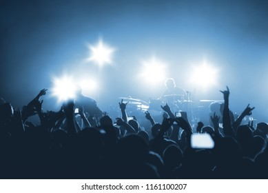silhouettes of rock musicians on stage. rock concert in a nightclub. silhouettes of the crowd at the music festival.