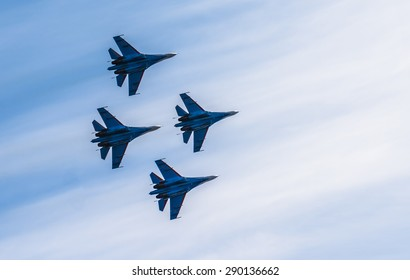 Silhouettes of russian fighter aircrafts in the sky