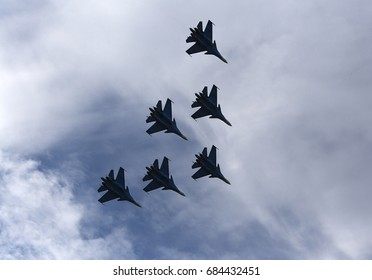 Silhouettes of russian fighter aircrafts in the sky. Russia, Moscow Airshow in July 2017